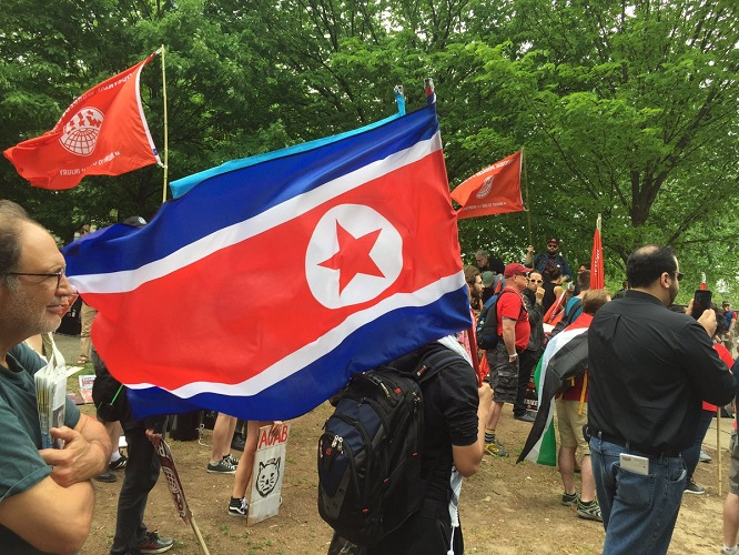 BREAKING #MayDay Video: Journalist Attacked For Asking May Day Protesters Why They're Carrying North Korean Flag