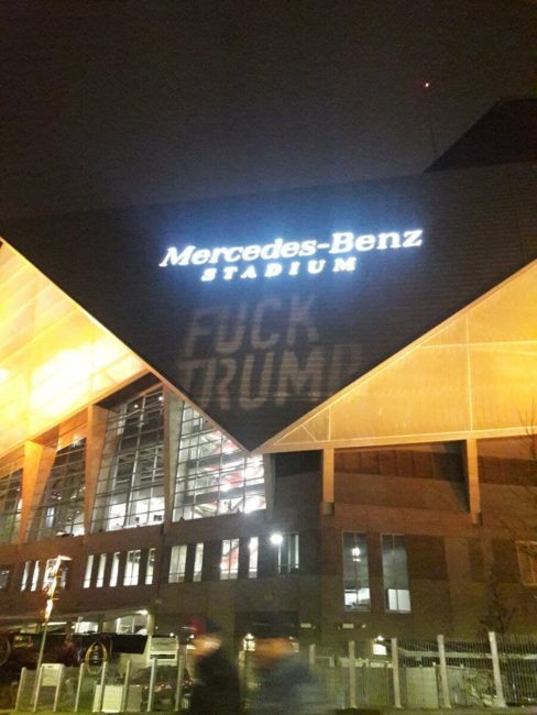 SHOCKING: Democrats Promote 'F*** Trump' Projected in Huge Letters As President Trump Attends College Football Championship Game