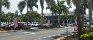 Florida Dealership Forced To Remove American Flag Banners Or Pay County Code Violation Fine