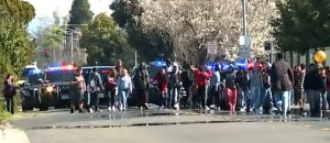 Watch High School Anti-Gun Rally Turn Violent: Students Beat Cop, Steal His Baton, & Smash Police Car