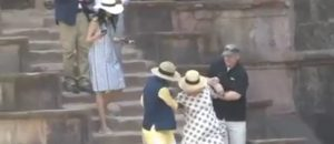 Hillary Slips Down Stairs TWO TIMES Despite Two Men Desperately Trying To Hold Her Up (Video)